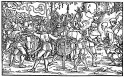 Aufständische Bauern mit Bundschuhfahne umzingeln einen Ritter. Holzschnitt des sog. Petrarca-Meisters aus dem ''Trostspiegel'', 1539. Lizenzstatus: Public Domain. Quelle: selbst gescannt / User Rosenzweig on Wikimedia Commons