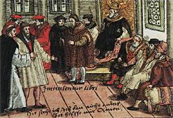 Luther auf dem Reichstag zu Worms. Kolorierter Holzschnitt von 1557. Bildaufschrift: Intitulentur libri (Die Bücher sollen bei ihren Titeln genannt werden). Hier stehe ich, ich kann nicht anders. Gott helfe mir, Amen. Wikimedia Commons / Quelle: ?, Urheber: ?